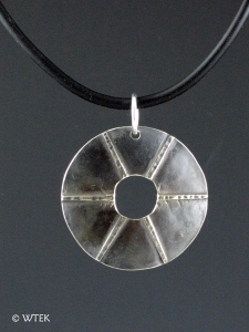 Spokes - fold formed nickel pendant on a rubber cord
