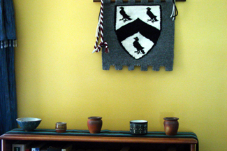small ceramic bowls thrown by my grandfather (and a wall hanging of the Kerwin crest that I made)