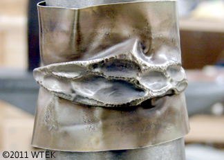 Cuff made using the chasing over air technique (and then formed into cuff shape)