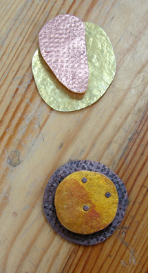"""Sherry was the only student to complete two pendants.  You can see the difference between the patinated one and the one left """"natural."""""""