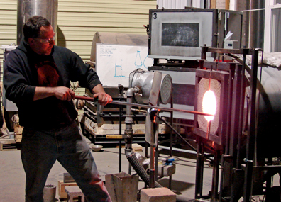 Kevin Lehman working on the glass cylinder.
