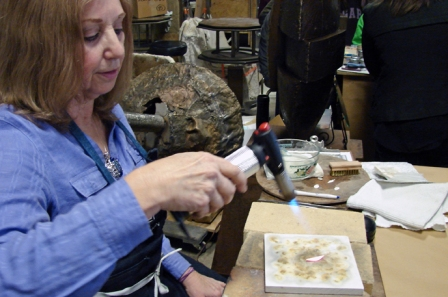 Leslie Scott firing her Precious Metal Clay