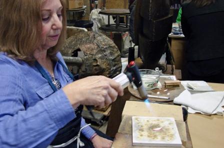 Leslie Scott firing her Precious Metal Clay