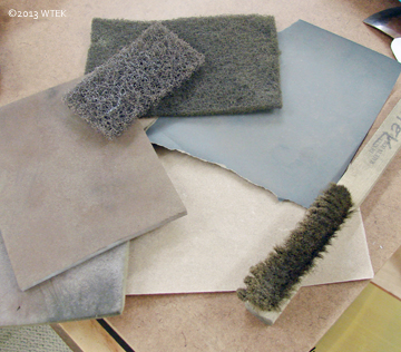 Sanding pads, sandpaper, scotchbrite pads, and my brass brush