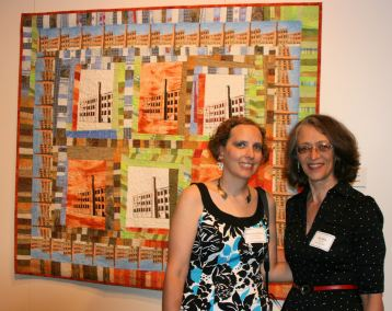 Sue Reno and Wendy Edsall-Kerwin in front of her piece, Silk Mill #3
