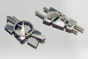 Pin P75-P and Object P74-P ©2010 E. Douglas Wunder, titanium, sterling silver