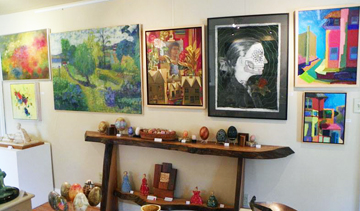 WOrk in the main room at JAM Gallery, including La Musa by Michael Weaver second from the right.