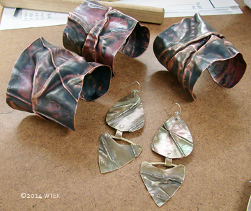 3 Wide Copper Fold Formed Cuffs and on pair of riveted, fold formed Brass earrings ©2014 WTEK