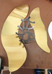 Pierced Wavy Vessel metal