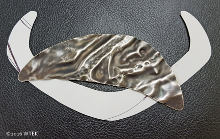 nickel fish with paper